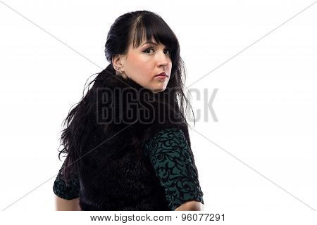 Portrait of pudgy woman in fur jacket, from back