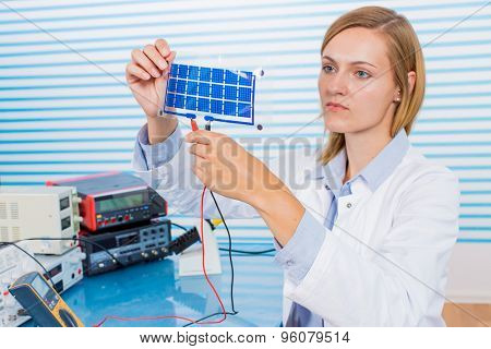 The technician is testing film solar cells poster