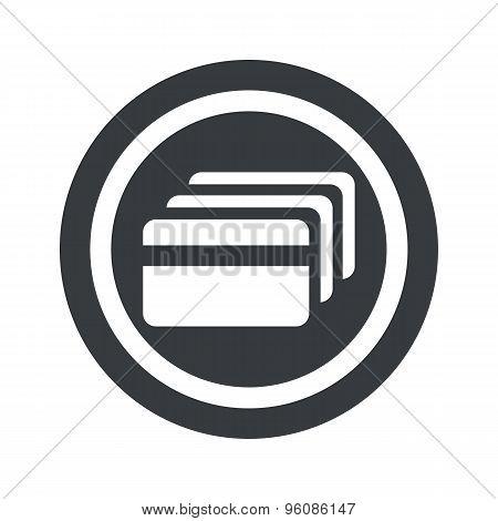 Round black credit card sign