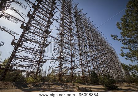 Duga-3 was a soviet early warning radar for anti-ballistic missile system located near Chernobyl. Now it is abandoned. poster