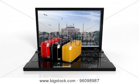 Suitcases on black laptop keyboard with Istanbul on screen, isolated