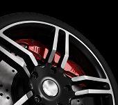 Super car disc-brake Isolated on black background poster
