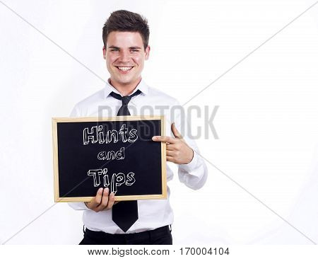 Hints And Tips - Young Smiling Businessman Holding Chalkboard With Text