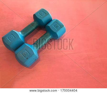Free weights on matt.  Health and fitness concept image