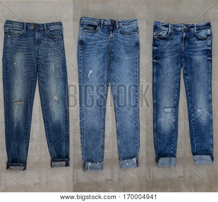 Set of three blue jeans trouser isolated-gray background