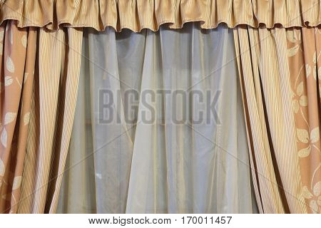 Background with a texture of portiere on a window