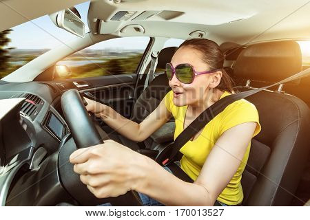 Woman is practicing driving the car