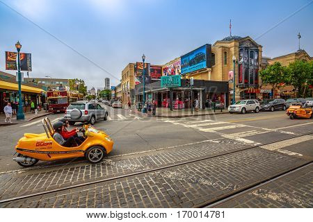 San Francisco, California, United States - August 14, 2016: GoCar Sightseeing Tour at Fisherman's Wharf waterfront. Freedom travel concept. San Francisco street view. America travel tourism.