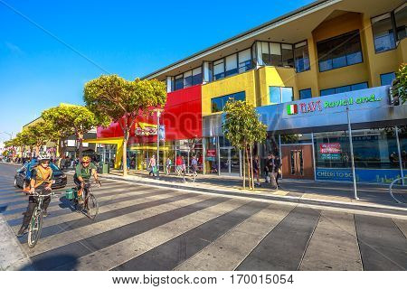 San Francisco, California, United States - August 14, 2016: people by bicycles on popular Jefferson road. San Francisco street view. Summertime. waterfront of Fisherman's Wharf. America travel tourism