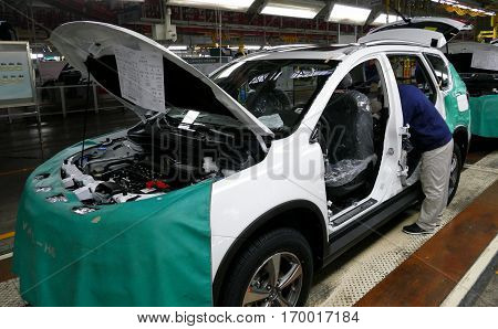 Tianjin, China. December 17Th 2016: Workers Assemble A Car On Assembly Line In Car Factory