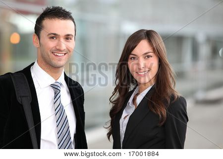 Portrait of business people standing outside the airport