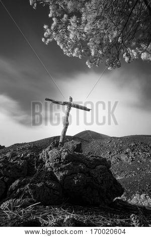 wooden cross of De Fiore craters born on 1974 in Etna Park, Sicily