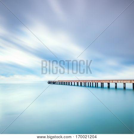 Concrete pier or jetty on a sea. Marina di Carrara Tuscany Italy. Long exposure photography