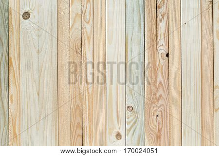 Light agreeable decorative wood background from variety of narrow strips textured and with knots