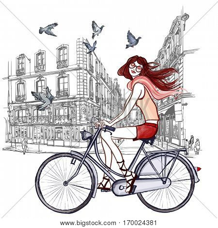 woman riding a bicycle in Paris - vector illustration