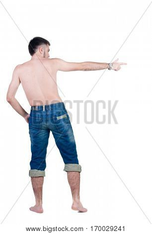 seminude young man in jeans pointing. rear view. Isolated over white.