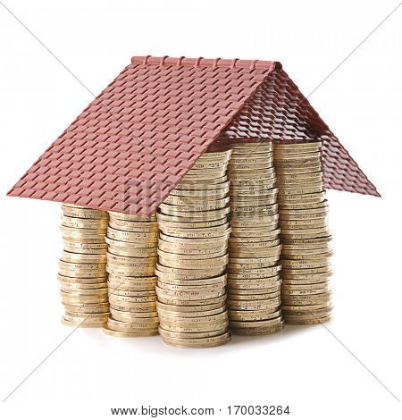 Money house made from lots of coins isolated on white background for house investment concept.