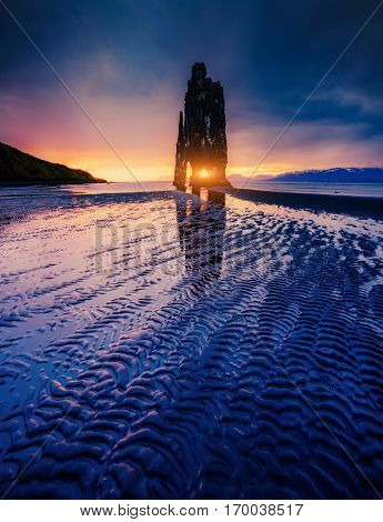 Textured dark sand after the tide. Picturesque and gorgeous scene. Location famous place Hvitserkur rock, Vatnsnes peninsula, northwest Iceland, Europe. Popular tourist attraction. Beauty world.
