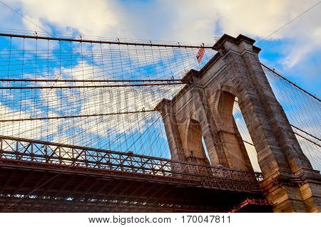 Clouds above Brooklyn Bridge, wide angle view - New York Brooklyn Bridge pylon