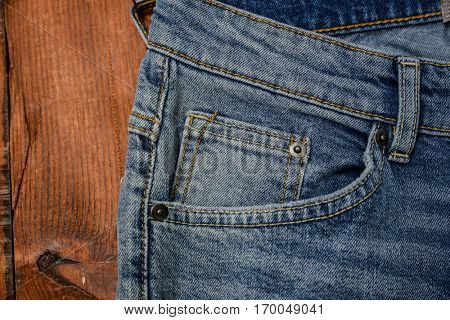 Details from blue jeans and board background