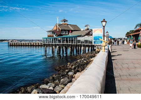 SAN DIEGO, CALIFORNIA - JANUARY 8, 2017:  Walkway at Seaport Village, entertainment, shopping and restaurant complex on the waterfront near downtown.