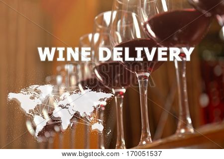 Glasses of red wine on table. Text WINE DELIVERY on background