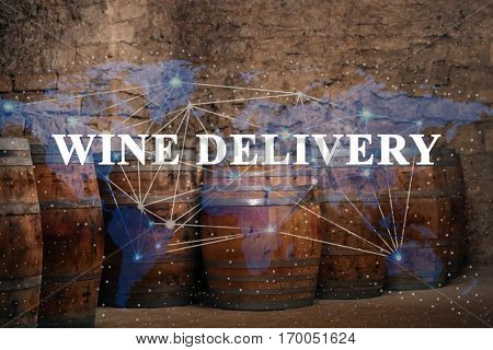 Wine barrels in cellar. Text WINE DELIVERY and world map on background