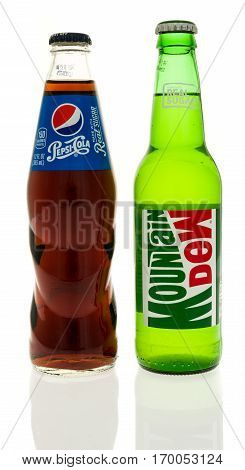 Winneconne WI -5 February 2017: Bottle of Mountain Dew and Pepsi with real sugar on an isolated background.