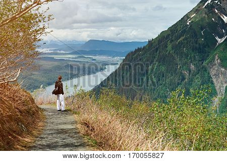 One man photographer hiking in mountains path. Man in travel tourism hiking background