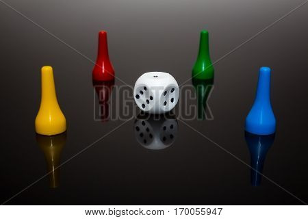 Rolling red dice over black grey background