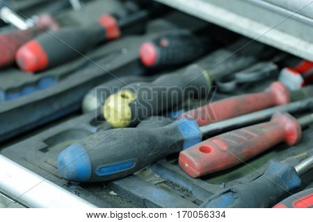 Close up set of previously used dirty screwdrivers