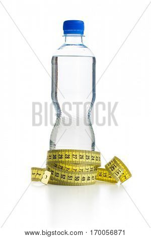 Water bottle and measuring tape isolated on white background.
