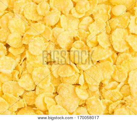 Dry Cornflakes for Breakfast Background. Healthy Cereal Vegetarian or Vegan Food