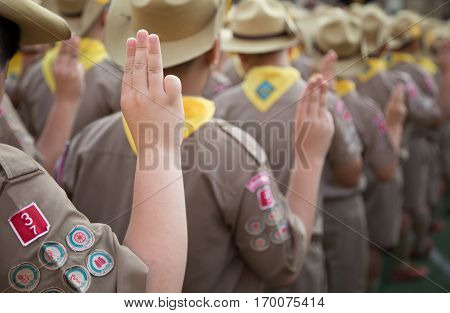 Group Of Asian Boy Scouts Oath Explained In Camp Activities As Part Of The Study. Boy Scout Troop Me