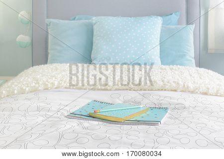 Light Blue Notebooks Setting On Biege Color Blanket With Light Blue Interior Bedroom