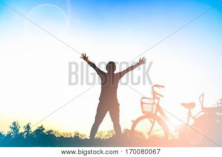 Young man relaxing in summer sunset. People freedom style.