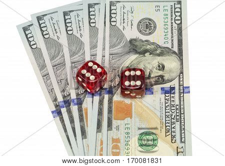 U.S. dollars and dice isolated on white background