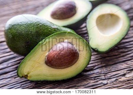 Avocado. Cut avocado on a oak wood background table. Selective focus.