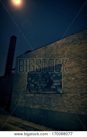 Dark vintage urban city alley at night with smokestack
