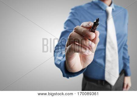 Hand man holding a pen