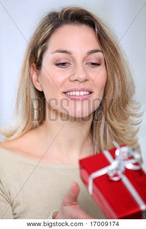 Closeup of woman reciving gift