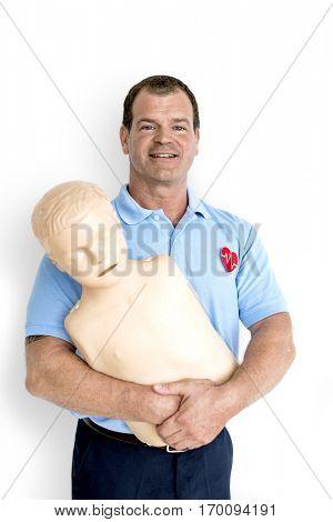 Man Paramedic CPR Dummy Mannequin Medication Concept