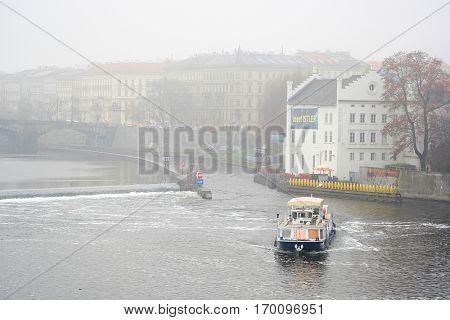 Prague,  Czechia - November, 24, 2016: Ship on Vitava river in Prague, Czechia