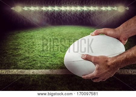 Sports player holding ball against rugby pitch 3D