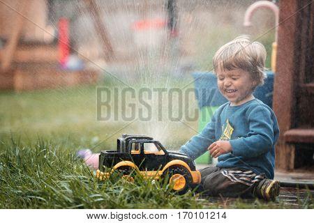 Young boy with hose and machine. washing machine. so happy boy