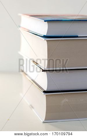 a stack of thick new books on white background