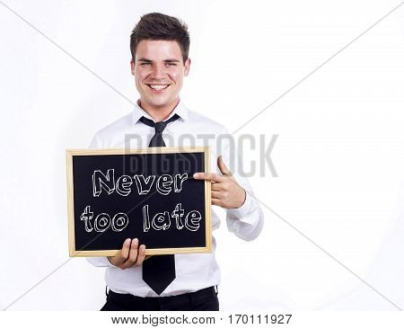 Never Too Late - Young Smiling Businessman Holding Chalkboard With Text