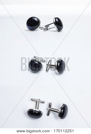 Cufflinks of glass multicolored beads on white background