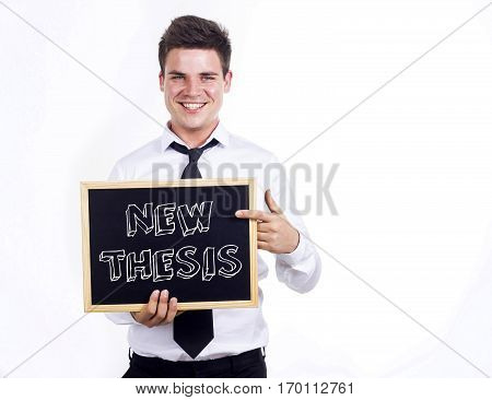 New Thesis - Young Smiling Businessman Holding Chalkboard With Text