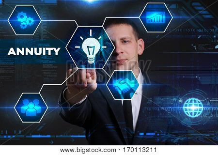 Business Technology Internet and network concept. Young businessman working on a virtual blackboard of the future he sees the inscription: annuity poster
